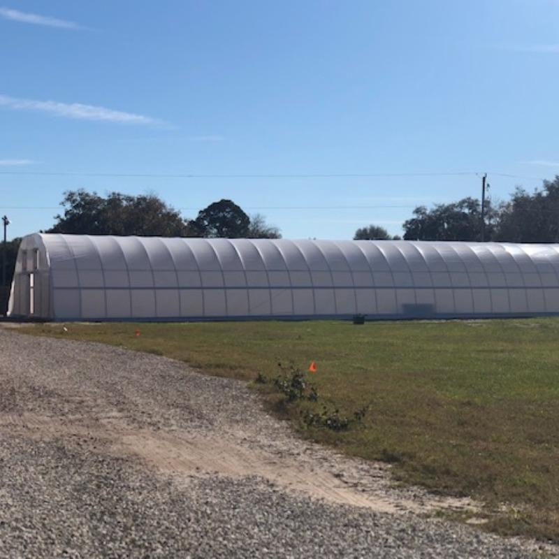 high hoop greenhouse exterior